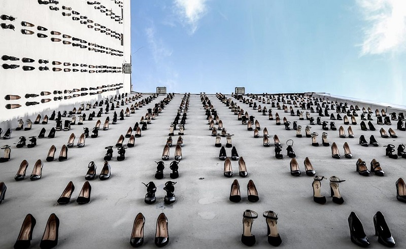 440 Pairs of High Heels Stuck On A Building to Signify the
